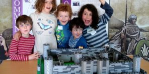 Children with the final build of Harlech Castle out of LEGO