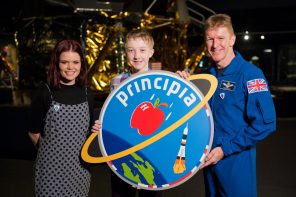 Time Peake and Blue Peter present award to Troy winner of the design a mission patch for Tim